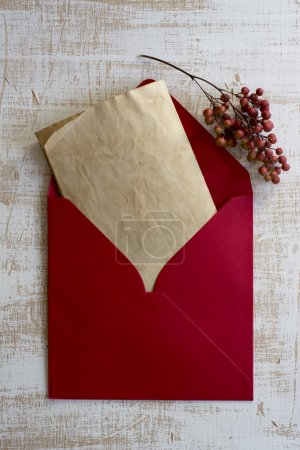 Photo for Red envelope, vintage letter, weathered white wood - Royalty Free Image