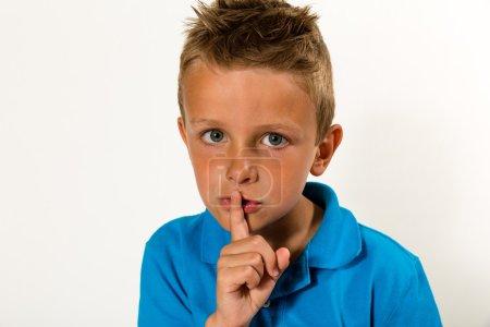 Boy making keep quiet gesture