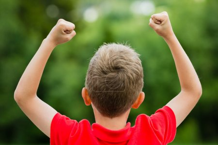 Child with raised fists