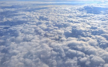 Photo for Clouds aerial view from airplane window - Royalty Free Image