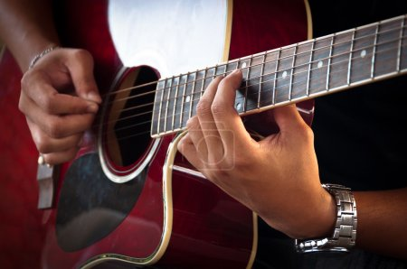Photo for Hands of Young Man Playing Acoustic Guitar - Royalty Free Image