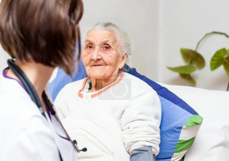 Young  nurse caring for  elderly patients helping ...