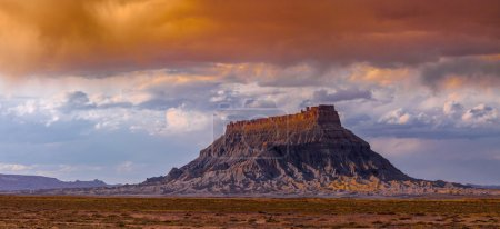 Photo for Factory Butte is the most recognizable feature of a large area of stark, barren land either side of the Fremont River known as the Upper Blue Hills, bordered by Capitol Reef to the west, the Henry - Royalty Free Image