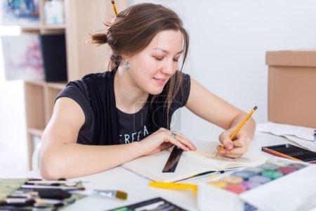 artist drawing sketch using sketchbook