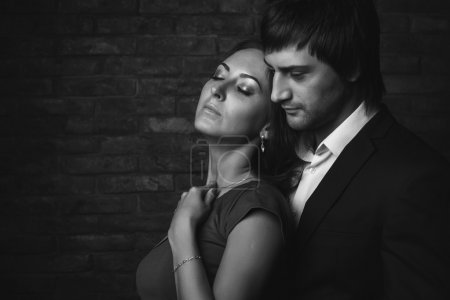 Romantic couple closed eyes enjoying spend time together. Black and white portrait.