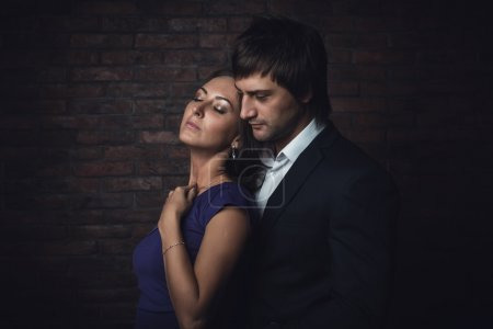 Romantic couple closed eyes enjoying spend time together. Portrait.