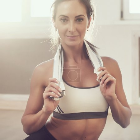 Photo for Sunny portrait of beautiful athletic sportive woman after the training  using  toned style instagram filters.  Toned photo Instagram filter - Royalty Free Image