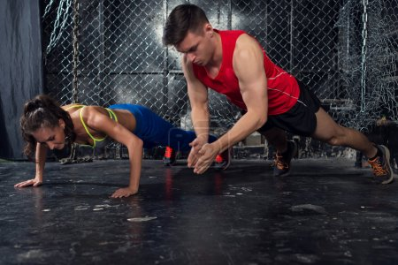 Photo for Sportsmen. fit male trainer man and woman doing clapping push-ups explosive strength training concept crossfit fitness workout strenght power - Royalty Free Image
