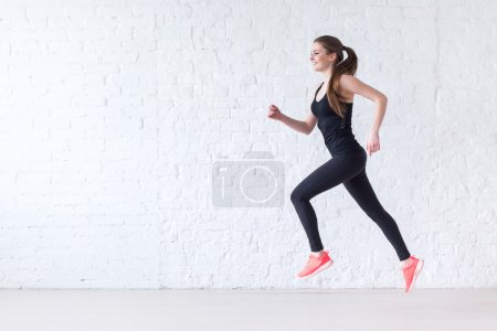 Photo for Side view of active sporty young running woman runner athlete with copy space concept sport health fitness loss weight cardio training jog workout wellness - Royalty Free Image