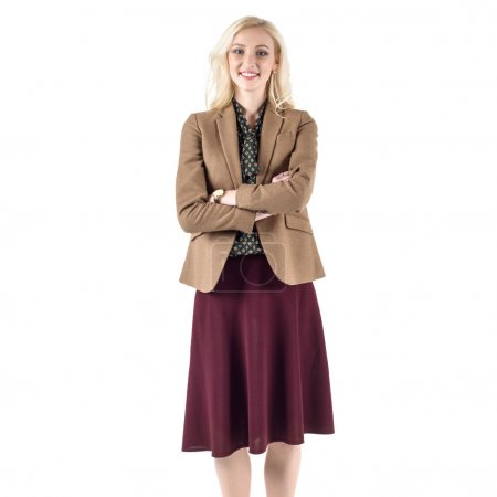Stunning blond businesswoman standing in the office and smile isolated on white background.