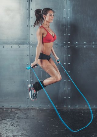 Photo for Sporty woman jumping skipping rope concept sport health fitness loss weight cardio training workout wellness - Royalty Free Image
