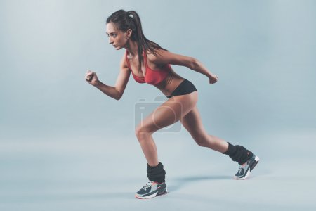 Photo for Sportive athlete woman sprinter waiting for the start running position fitness, sport, training and lifestyle concept - Royalty Free Image
