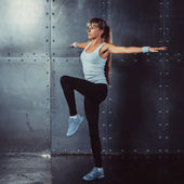 Fitness, sport concept woman working out and standing in yoga pose
