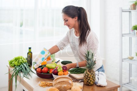 Woman preparing dinner in a kitchen concept cooking, culinary, healthy lifestyle.