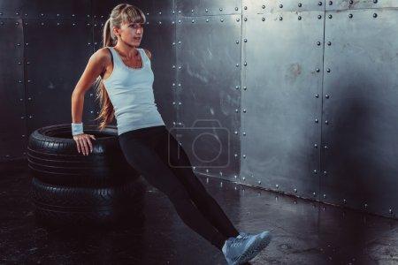 athlete woman doing push-ups
