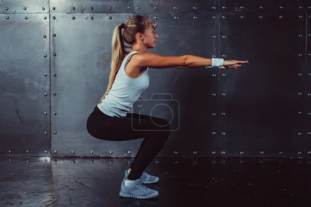 Athletic young woman fitness model