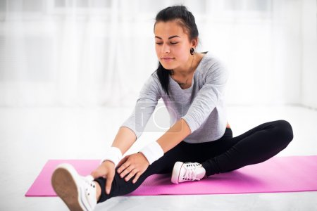 Fit woman doing aerobics gymnastics