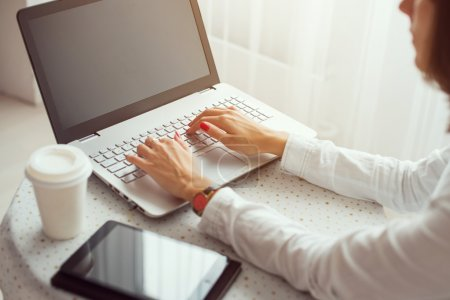 Photo for Freelancer using laptop, woman working on laptop computer typing on the keyboard at home. - Royalty Free Image