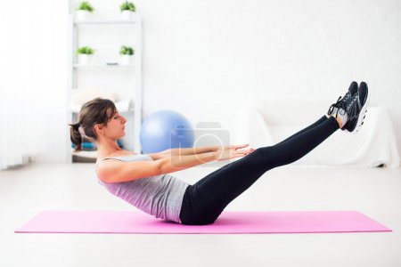 Woman doing abdominal exercise