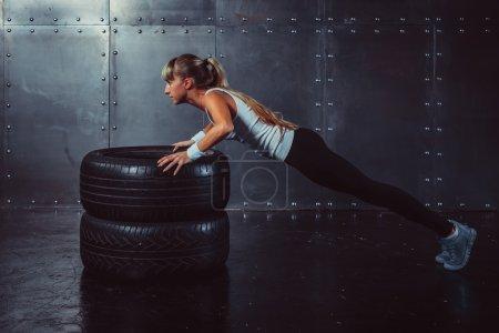 Sportswoman. Fit sporty athlete woman doing push ups