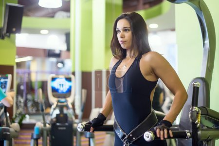 Athlete woman workout out arms