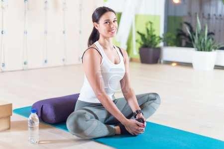 Fit woman doing stretching pilates