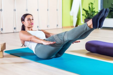 Fit woman stretching at yoga class