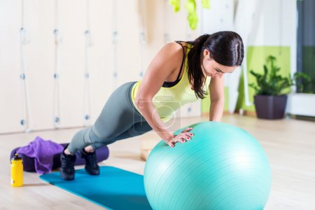 Fit woman doing push