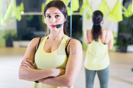Female sports trainer with microphone
