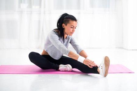 Fit woman doing aerobics gymnastics