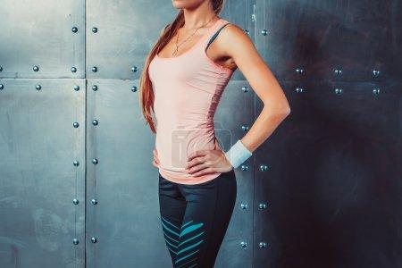 Sportswoman showing perfect female body