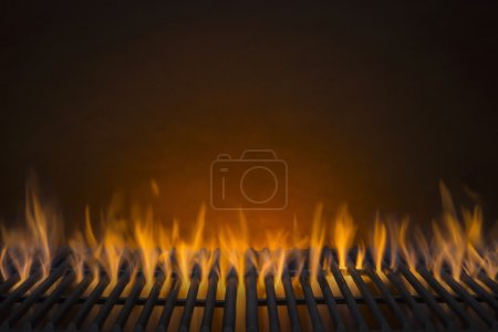 Photo for Flaming Hot Barbecue Grill and a Glowing Amber Background - Royalty Free Image