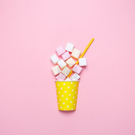 Photo for Top view of the pastel marshmallows on a pink background. - Royalty Free Image