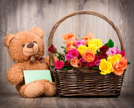 Fresh roses with teddy bear