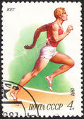 USSR - CIRCA 1981: A stamp printed in  the USSR shows a running man, the series Sport, circa 1981