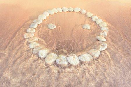 Emoticon of pebbles