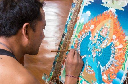 Photo for DHARAMSALA, INDIA - AUG 26: Tibetan artist creates traditional Thangka painting at the Tibetan Arts Conservation Center of Norbulingka. - Royalty Free Image