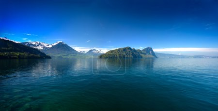 Panoramic view of Lucerne lake with swiss alps in spring