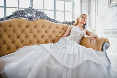 Photo for Beautiful blonde bride with perfect makeup and hair style in elegant interior - Royalty Free Image