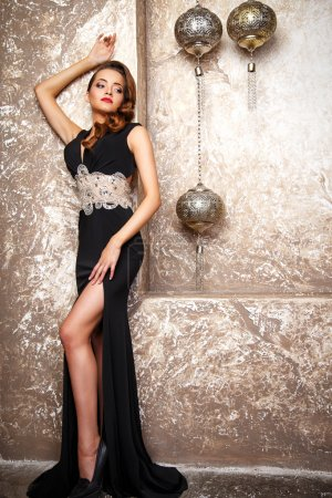 Photo for Portrait of beautiful elegant young woman in gorgeous evening dress - Royalty Free Image