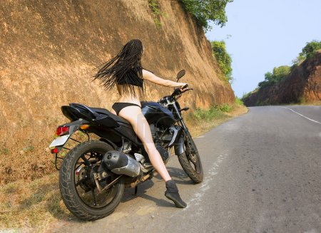 Biker theme: beautiful woman with sexy body and st...