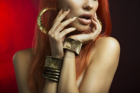 Redhead Women with Golden Make-up, Hands with Golden Manicure. M
