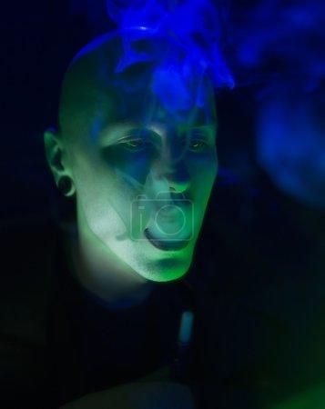 Club Party - Nightlife. Handsome Sexy Young Stylish Man Smokin