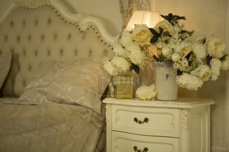 Luxury Royal Interior. Luxurious bed with cushion and stand lamp