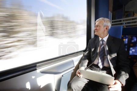 businessman sitting at train