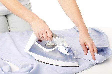 Woman  ironing shirt.