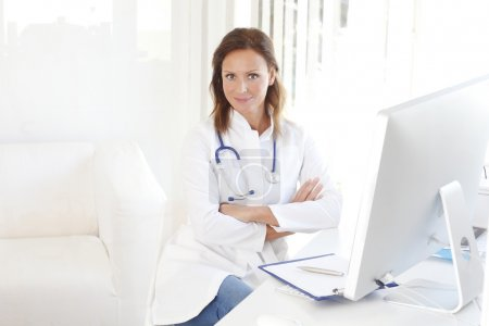 doctor sitting at private clinic