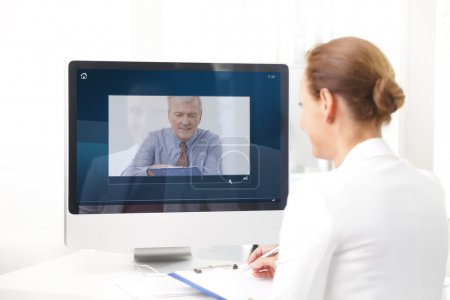 assistant having video chat with executive businessman