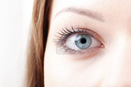 young woman's blue eye