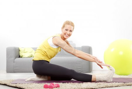 blonde woman doing stretching exercise